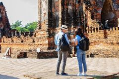 Eastern Asia summer holidays. Caucasian man and Asian woman tourist from back looking at Wat Chaiwatthanaram temple. Tourist. Eastern Asia summer holidays royalty free stock images