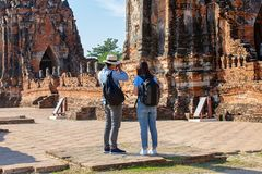 Eastern Asia summer holidays. Caucasian man and Asian woman tourist from back looking at Wat Chaiwatthanaram temple. Tourist. Eastern Asia summer holidays royalty free stock image