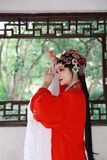 Aisa Chinese opera woman.Peking Beijing Opera in the garden outdoor china traditional costume bride role drama play royalty free stock image