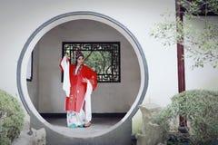 Aisa Chinese woman Peking Beijing Opera Costumes Pavilion garden China traditional role drama play dress dance perform fan ancient. Eastern Asian oriental stock photo