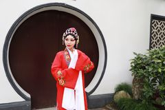 Aisa Chinese opera woman.Peking Beijing Opera in the garden outdoor china traditional costume bride role drama play royalty free stock images