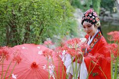 Aisa Chinese woman Peking Beijing Opera Costumes Pavilion garden China traditional role drama play bride hold red Umbrella royalty free stock image