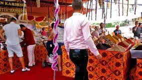 The eastern bazaar in Antalya. ANTALYA, TURKEY - MAY 13, 2017: People in Eastern bazaar choose sweets and beverages - Turkish delight rahat lokum, fruit tea stock video