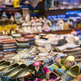 Eastern bazaar - handmade shoes. Image of selling point at Istan. Bul market with large selection of traditional arabic handmade ornate shoes Royalty Free Stock Photography