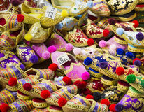Eastern bazaar - handmade shoes. Image of selling point at Istan. Bul market with large selection of traditional arabic handmade ornate shoes Stock Photography
