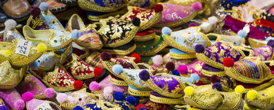 Eastern bazaar - handmade shoes. Image of selling point at Istan. Bul market with large selection of traditional arabic handmade ornate shoes Stock Images