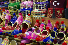 Eastern bazaar - handmade shoes. Image of selling point at Istanbul market with large selection of traditional arabic handmade ornate shoes Royalty Free Stock Images