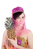 Eastern beauty with the pineapple Stock Photo