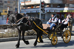 Eastern car. Every March, the Bulgarian community in Targoviste city of Romania celebrates the Eastern of the horses. People thank the horses for their help at Stock Photo
