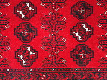 Eastern carpet. Bright red Eastern carpet with pattern Stock Photos