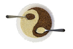 Eastern cuisine - sesame seeds in yin yang shape plate Royalty Free Stock Photos