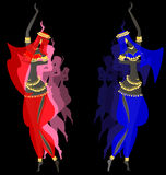 Eastern dancing girls. Dark background and two dancing oriental fairy girls in red-blue dress Stock Photo