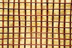 Eastern Decor Crisscross Grid Lattice Background. Asian inspired Eastern decor style background with decorative brown wood reeds in a crisscross grid lattice royalty free stock photography
