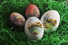 Eastern decoration. Hand-painted eggs on green grass Stock Photos
