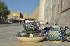 Eastern dishes are sold on the streets of Bukhara. Eastern dishes and Uzbek Souvenirs are sold on the streets of Bukhara Stock Photo