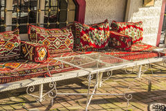Eastern Divan with cushions and a glass table in a cafe. In Istanbul Stock Image