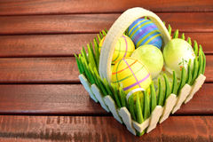 Eastern eggs and basket Royalty Free Stock Images