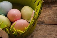 Eastern eggs in green basket Stock Image