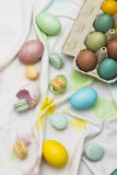 Eastern eggs and macarons Stock Photography