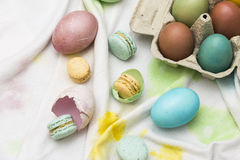 Eastern eggs and macarons Royalty Free Stock Image