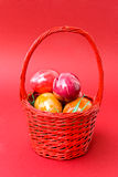 Eastern eggs in the red basket Stock Photo