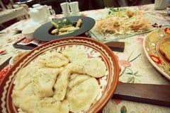 Eastern European restaurant dish - Potatoes vareniki in a ceramic bowl. In selective focus Royalty Free Stock Photo