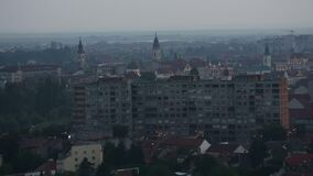 Eastern European Town Skyline With Communistic Apartments and Churches