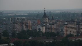 Eastern European Town Skyline With Orthodox Church Surrounded By Communistic Apartments