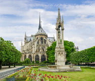 Eastern facade of the Cathedral Notre-Dame de Paris. View of the eastern facade of the Cathedral Notre-Dame de Paris with the fontaine of Virgin on the Royalty Free Stock Photos