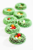 Eastern, fondant rings with green sugar pearls, sugar eggs Royalty Free Stock Images