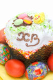 Eastern food. Glazed and decorated Easter cake and eggs Stock Photos
