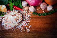 Eastern food spice herb rice garlic chilly pepper mint leaves red onion green pepper on wood table background Stock Photos