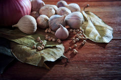 Eastern food style dry spice herb garlic red onion white pepper dry leaves  on wood table Stock Photo