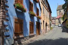 The street of Ribeauvillé village. Wine road of Alsace. Eastern France. Alsace region. A beautiful village named Ribeauville on the famose Wine road. It has Stock Photo