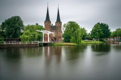 Eastern gate, canal and historic drawbridge in Delft, Netherland Royalty Free Stock Photography