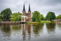 Eastern gate, canal and historic drawbridge in Delft, Netherland royalty free stock image
