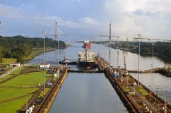 Eastern Gateway to the Panama Canal. Two westbound container ship preparing to enter the Gatun Locks on the Panama Canal Stock Photography