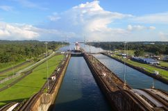 Eastern Gateway to the Panama Canal. Two westbound container ship preparing to enter the Gatun Locks on the Panama Canal Royalty Free Stock Photography