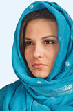 Eastern girl. Portrait of a girl in a blue scarf Stock Photography