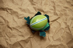 Eastern green egg in hole brown wrapping paper Stock Photography