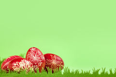 Eastern handmade traditional eggs background. Traditional eastern eggs on artificial green grass Stock Photography