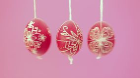 Eastern handmade traditional eggs hanging on rope Royalty Free Stock Photography