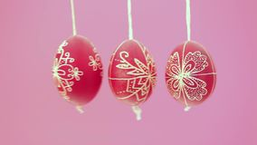 Eastern handmade traditional eggs hanging on rope Royalty Free Stock Photo
