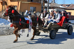 Eastern happy. Every March, the Bulgarian community in Targoviste city of Romania celebrates the Eastern of the horses. People thank the horses for their help at Stock Image