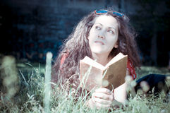 Eastern hipster vintage woman reading book Stock Photography