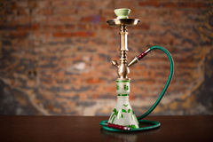 Eastern hookah on wood table. Close up Stock Photos
