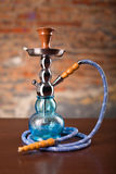 Eastern hookah on wood table. Close up Royalty Free Stock Photography
