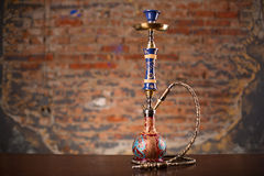 Eastern hookah on wood table. Isolated in studio close up Royalty Free Stock Photos