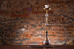 Eastern hookah on wood table. In studio close up Stock Photo