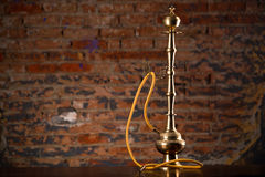 Eastern hookah on wood table. In studio close up Stock Image